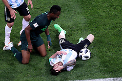 Argentina's Lionel Messi (right) holds his head on the pitch as Nigeria's John Obi Mikel leans over him during the FIFA World Cup Group D match at Saint Petersburg Stadium. PRESS ASSOCIATION Photo. Picture date: Tuesday June 26, 2018. See PA story WORLDCUP Nigeria. Photo credit should read: Owen Humphreys/PA Wire. RESTRICTIONS: Editorial use only. No commercial use. No use with any unofficial 3rd party logos. No manipulation of images. No video emulation
