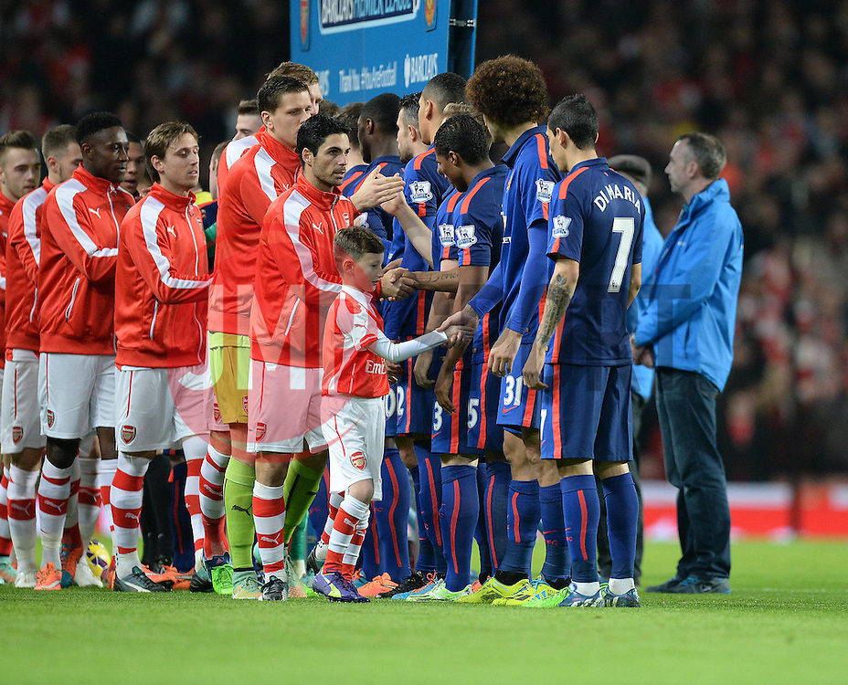 Both teams shake hands prior to kick off led by Arsenal's Mikel Arteta - Photo mandatory by-line: Alex James/JMP - Mobile: 07966 386802 - 22/11/2014 - Sport - Football - London - Emirates Stadium - Arsenal v Manchester United - Barclays Premier League