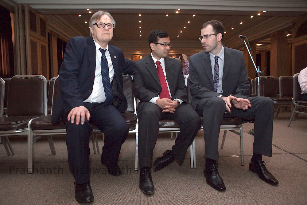 Professor, Juha Hernesniemi(L) looks on as Dr. Martin Lehecka (far right), speak to an Indian neurosurgeon prior to lecturing and performing three neurosurgeriesi n front of 170 Indian neurosurgeons at Bombay Hospital in Mumbai, India, on Sunday, April 17, 2011. Photographer: Prashanth Vishwanathan/HELSINGIN SANOMAT