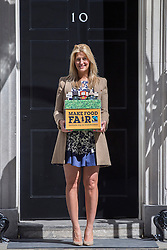 © licensed to London News Pictures. London, UK 09/05/2013. Made in Chelsea's Cheska Hull hands over a petition to Number 10, Downing Street, calling for the government to support global food security. Fairtrade campaigners and members of The Co-operative are asking the government to use the G8 summit to unlock greater support for smallholder farmers. Photo credit: Tolga Akmen/LNP