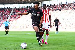 Antoine Semenyo of Bristol City is challenged by Badou Ndiaye of Stoke City - Rogan/JMP - 14/09/2019 - Bet365 Stadium - Stoke, England - Stoke City v Bristol City - Sky Bet Championship.