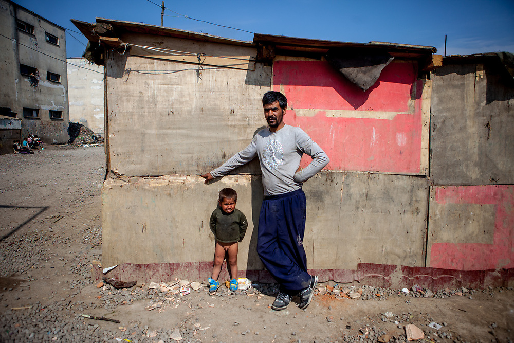 "Karol - father of eleven children with one of his sons at the Roma settlement located at ""Budulovska Street"" in Moldava nad Bodvou about 30 km from Kosice. From about 800 inhabitants of the segregated settlement 'Budulovska Street' (2014) are roughly 392 children up to the age of 16 years."