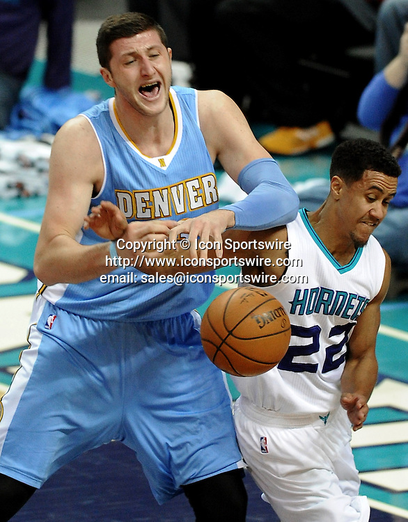 Dec. 22, 2014 - Charlotte, NC, USA - Denver Nuggets center Jusuf Nurkic (23) and Charlotte Hornets guard Brian Roberts (22) fight for control of the ball during first half action on Monday, Dec. 22, 2014, at Time Warner Cable Arena in Charlotte, N.C