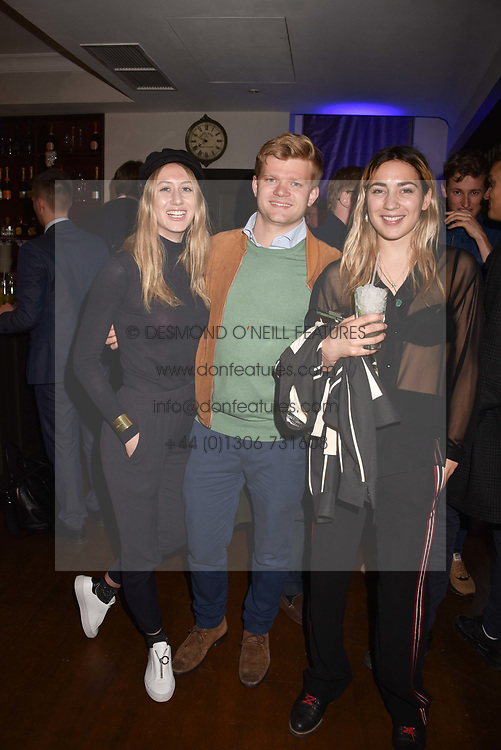 Left to right, Ella Donald, Lord Porchester and Belle Hutley at The Tribe Syndicate launch party hosted by Highclere Thoroughbred Racing at Beaufort House, 354 King's Rd, London England. 25 April 2018.