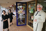 KFC and other fast food chains, both global and Japanese, are a frequent stop for busy Okinawans. Although the island is being studied for clues to Okinawan's great longevity, studies say that the younger population will not live as long because of their diets higher in saturated fats and calories. (Supporting image from the project Hungry Planet: What the World Eats).