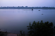 Fishermen at dawn on the Narmada River in Khargone, Madhya Pradesh, India on 13 November 2014. Photo by Suzanne Lee for Fairtrade