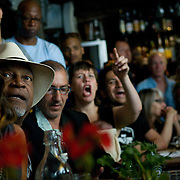 Date: 6/11/10..Fans watch the scoreless first half of the 2010 World Cup opening Group A match between South Africa and Mexico at Madiba, a South African restaurant in Fort Greene, Brooklyn on June 11, 2010.   The game finished in a 1-1 tie. ..Photo by Angela Jimenez for Newsweek .photographer contact 917-586-0916/angelajime@gmail.com