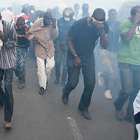 Senegalese anti government demonstrators run in thick tear gas fired at them by police during riots in Dakar, Senegal, 21 February 2012. Violent demonstrations against incumbent President Abdoulaye Wade's re-election bid continue in the capital Dakar ahead of presidential elections. Protesters are demonstrating against a ruling by the country's top judges allowing President Abdoulaye Wade to seek a third term in office. Presidential elections are scheduled for 26 February 2012.
