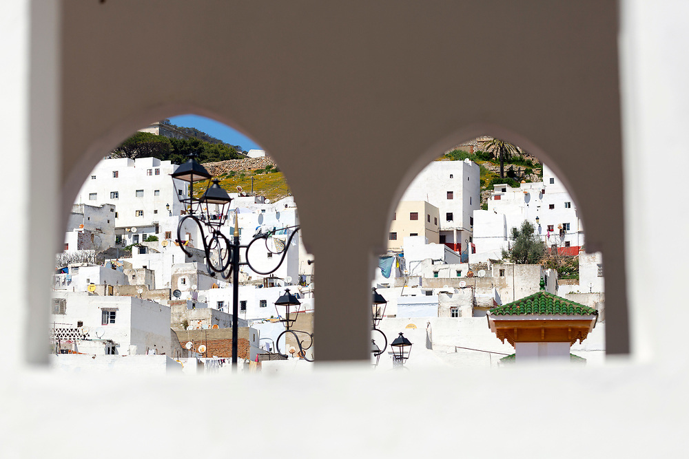 TETOUAN, MOROCCO - 6th April 2016 - Abstract image of the Tetouan Medina seen through two arched window shutters, Rif region of Northern Morocco.