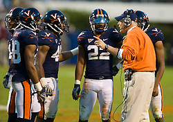 "Virginia head coach Al Groh instructs his defense before the start of the overtime period.  The Virginia Cavaliers defeated the #18 ranked North Carolina Tar Heels 16-13 in overtime in NCAA football at Scott Stadium on the Grounds of the University of Virginia in Charlottesville, VA on October 18, 2008.  The 113th meeting of the two teams, dubbed the ""Oldest Rivalry in the South"", saw UVA continue its streak of consecutive home victories over UNC -- the last time the Tar Heels won in Charlottesville was 1981."