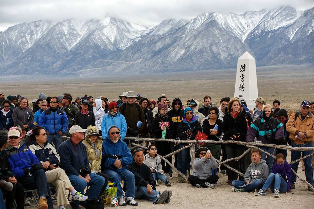 The Cemetery Obelisk stands as former internees and visitors gather at the Manzanar National Historic Site during the 47th Annual Manzanar Pilgrimage on Saturday, April 30, 2016 in the Owens Valley of Inyo County, Calif. Now a National Historic Site, the Manzanar War Relocation Center was one of ten camps where Japanese American citizens and resident Japanese aliens were interned during World War II. Photo by Patrick T. Fallon / Special to the National Parks Conservation Association