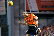 30th August 2019; Dens Park, Dundee, Scotland; Scottish Championship, Dundee Football Club versus Dundee United; Mark Reynolds of Dundee United heads clear from Danny Johnson of Dundee