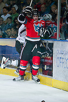 KELOWNA, CANADA - NOVEMBER 30: JT Barnett #17 of the Kelowna Rockets checks an opponent into the boards against the Moose Jaw Warriors at the Kelowna Rockets on November 30, 2012 at Prospera Place in Kelowna, British Columbia, Canada (Photo by Marissa Baecker/Getty Images) *** Local Caption ***
