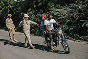 Officers of the border security division of the Dominican Military (CESFRONT) stop a woman who had tried repeatedly to cross into Dominican Republic at the Jimaní border with Haiti. Checkpoints like these are ubiquitous on all roads leading into the country from the border and an integral part of enforcing the new immigration laws.