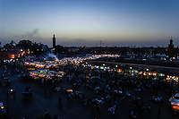 Morocco, Marrakesh. Jamaa el Fna is a square and market place in Marrakesh's medina quarter (old city). After dark, smoke rises from food stalls.