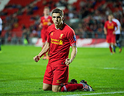 ST HELENS, ENGLAND - Monday, October 7, 2013: Liverpool's Adam Morgan celebrates scoring the first goal against Tottenham Hotspur from the penalty spot during the Under 21 FA Premier League match at Langtree Park. (Pic by David Rawcliffe/Propaganda)