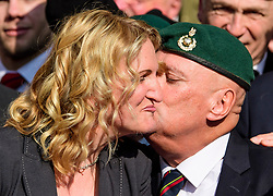 © Licensed to London News Pictures.28/03/2017.London, UK. CLAIRE BLACKMAN (C), wife of Sergeant Alexander Blackman, kisses a former Royal Marine as she leaves the Royal Courts of Justice in London, where a judge reduced the sentence for Sgt Blackman's manslaughter charge, meaning he will be free within weeks..Photo credit: Ben Cawthra/LNP