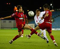 Photo: Marc Atkins.<br /> Milton Keynes Dons v Colchester United. Carling Cup. 22/08/2006. MK Don's  Gareth Edds (C) clears under pressure from Colchester's Kem Izzet (R)