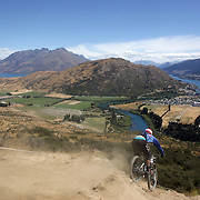 Reon Boe, Queenstown, in action during the New Zealand South Island Downhill Cup Mountain Bike series held on The Remarkables face with a stunning backdrop of the Wakatipu Basin. 150 riders took part in the two day event. Queenstown, Otago, New Zealand. 9th January 2012. Photo Tim Clayton