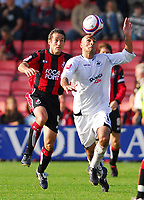 Photo: Leigh Quinnell.<br /> Bournemouth v Swansea City. Coca Cola League 1. 14/10/2007. Swanseas Darren Pratley gets to the ball before Bournemouths Paul Telfer.