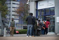 © Licensed to London News Pictures. 18/10/2016. Croydon, UK. People line up at the main entrance to Lunar House, the Home Office visa and immigration centre in Croydon. credit: Peter Macdiarmid/LNP