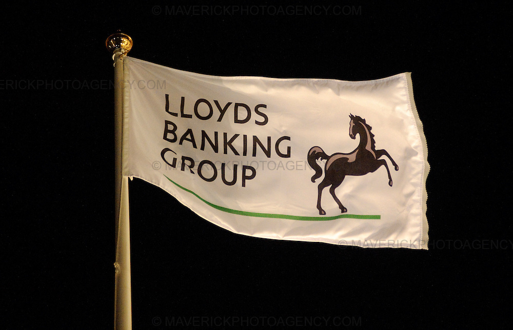 The new Lloyds Banking Group flag files on top of the Halifax Bank of Scotland headquarters building on the mound in Edinburgh city center.  Lloyds Banking Group was formed after  the two banks HBOS and Lloyds TSB merged.