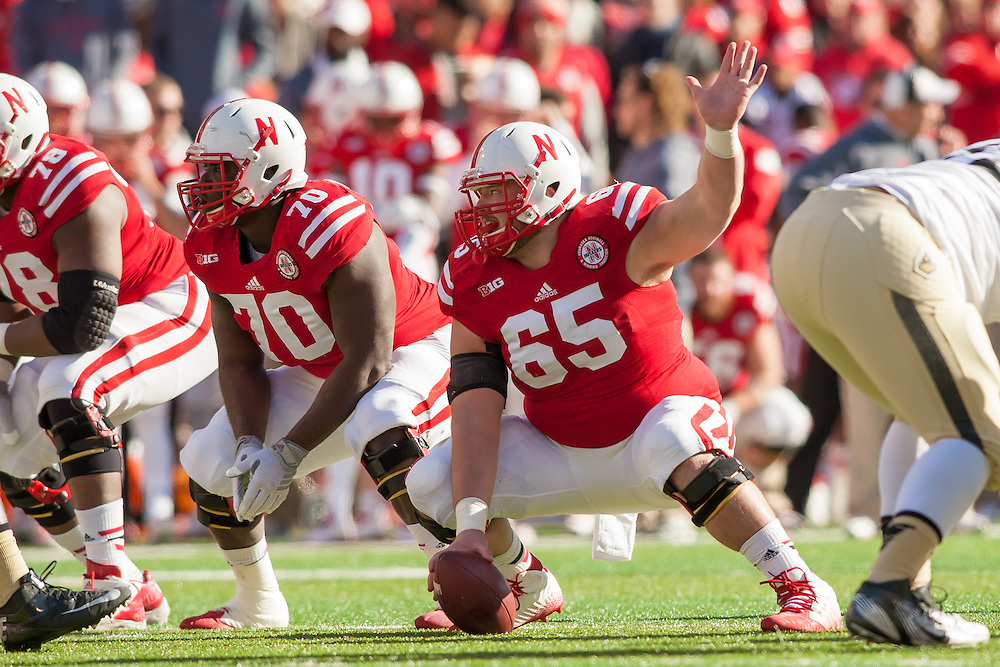 November 1, 2014: Ryne Reeves #65 of the Nebraska Cornhuskers signals as he is playing center during the game against the Purdue Boilermakers at Memorial Stadium in Lincoln, Nebraska. Nebraska 35 Purdue 14.