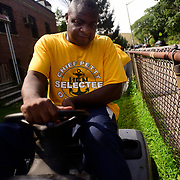 BRONX, NY - 8/18/2018 - Chief Select Hospital Corpsman Ernest Ahiable drives a mower in the front yard of Samuel H. Young American Legion Post 620 on Saturday as part of CPO365 Phase II. <br /> Ahiable and his class of U.S. Navy Chief Selects from Navy Operational Support Center New York volunteered at the American Legion in advance of the hall's 100th Anniversary, this fall. (U.S. Navy Photo by Chief  Mass Communication Specialist Roger S. Duncan / RELEASED )