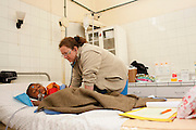 No. 74, Sidonie Haritiana, UCL, unilateral Cleft lip, female, 7 years old, <br /> after, is examined by Pediatric Intensivist Mary Morgan in the recovery room.<br /> <br /> Operation Smile South Africa<br /> Operation Smile Mission to Hospital Joseph Ravoanangy Andrianavalona,<br /> Antananarivo, Madagascar. September 17th - 29th 2011<br /> <br /> &copy; Operation Smile Photo / Zute &amp; Demelza Lightfoot<br /> www.lightfootphoto.com