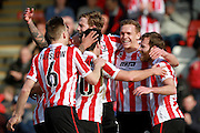 Danny Wright celebrates with his team mates after scoring a penalty for the Robins during the Vanarama National League match between Cheltenham Town and Boreham Wood at Whaddon Road, Cheltenham, England on 25 March 2016. Photo by Carl Hewlett