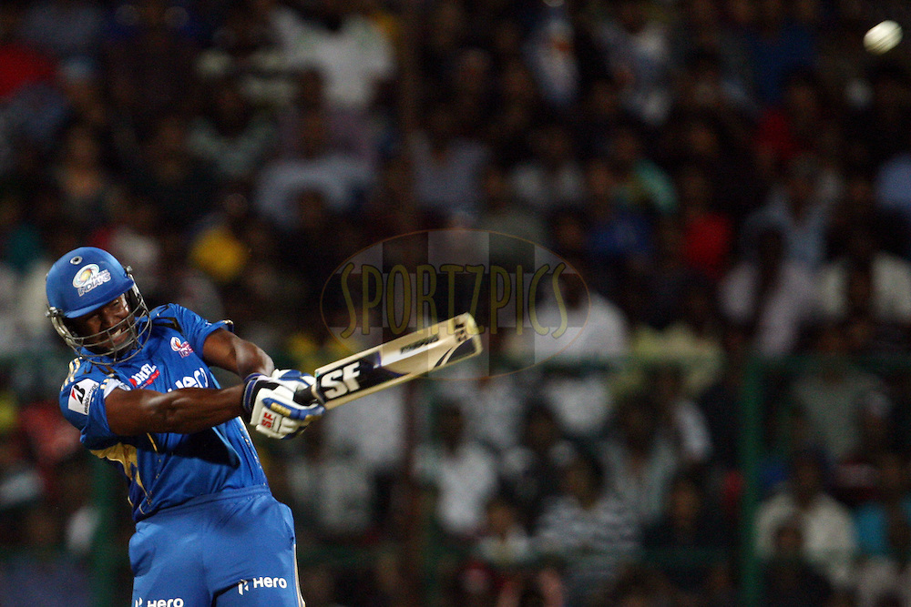 Dwayne Smith hits a massive six during the IPL 2012 Season 5 eliminator match between The Mumbai Indians and The Chennai Superkings held at the M. Chinnaswamy Stadium, Bengaluru on the 23rd May 2012..Photo by Jacques Rossouw/IPL/SPORTZPICS