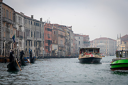 A view of various gondoliers and a boat bus on the Grand Canal in Venice. From a series of travel photos in Italy. Photo date: Sunday, February 10, 2019. Photo credit should read: Richard Gray/EMPICS Entertainment