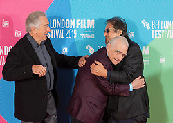Director Martin Scorsese (centre) with Robert De Niro (left) and Al Pacino (right) during a photocall for The Irishman as part of the BFI London Film Festival 2019 held at The May Fair Hotel , London.