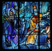 The baptism of Clovis, King of the Franks, by St Remy, stained glass window, 1974, by Marc Chagall, 1887-1985, with the studio of Jacques Simon, in the axial chapel of the apse of the Cathedrale Notre-Dame de Reims or Reims Cathedral, Reims, Champagne-Ardenne, France. The cathedral was built 1211-75 in French Gothic style with work continuing into the 14th century, and was listed as a UNESCO World Heritage Site in 1991. Picture by Manuel Cohen