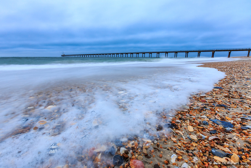 Cloudy twilight morning surf at the Army Corps of Engineers Research Pier in Duck, NC.