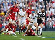 Jack Nowell of England breaks through Leigh Halfpenny of Wales during the RBS 6 Nations match at Twickenham Stadium, Twickenham<br /> Picture by Andrew Tobin/Focus Images Ltd +44 7710 761829<br /> 09/03/2014