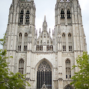 The front of the Cathedral of St. Michael and St. Gudula (in French, Co-Cathédrale collégiale des Ss-Michel et Gudule). A church was founded on this site in the 11th century but the current building dates to the 13th to 15th centuries. The Roman Catholic cathedral is the venue for many state functions such as coronations, royal weddings, and state funerals. It has two patron saints, St Michael and St Gudula, both of whom are also the patron saints of Brussels.