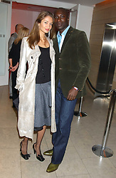 Fashion designer OZWALD BOATENG and his wife GYUNEL at a cocktail party hosted by MAC cosmetics to kick off London Fashion Week at The Hospital, 22 Endell Street London on 18th September 2005.At the event, top model Linda Evangelista presented Ken Livingston the Lord Mayor of London with a cheque for £100,000 in aid of the Loomba Trust that aims to privide education to orphaned children through a natural disaster or through HIV/AIDS.<br />