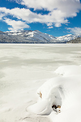"""Snow Covered Donner Lake 2"" - Photograph of a mostly iced over and snow covered Donner Lake, Donner Summit can be seen in the background."