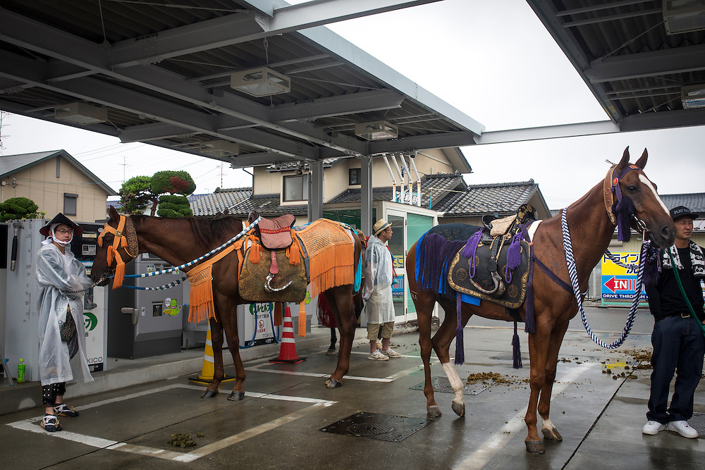 "MINAMISOMA, JAPAN - JULY 24 :  A samurai horses is seen in the gas station during the Soma Nomaoi festival at Minamisoma city on Sunday, July 24, 2016 in Fukushima Prefecture, Japan. ""Soma-Nomaoi"" is a three day traditional festival that recreates a samurai battle scene from more than 1,000 years ago. The festival has gathered more than thousands visitors as Fukushima still continues to recovery from the 2011 nuclear disaster, the samurai warriors battles for recovery of the area. (Photo: Richard Atrero de Guzman/NURPhoto)"