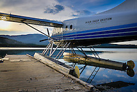 A Blacksheep Aviation Turbo Otter rests as the sun rises on Schwatka Lake, Yukon, Canada.