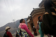 Some tibetan women from the Amdo region are following the pilgrimage path in the monastery of Labrang, where riots have erupted in march 2008. Downside videocameras are now monitoring the streets...
