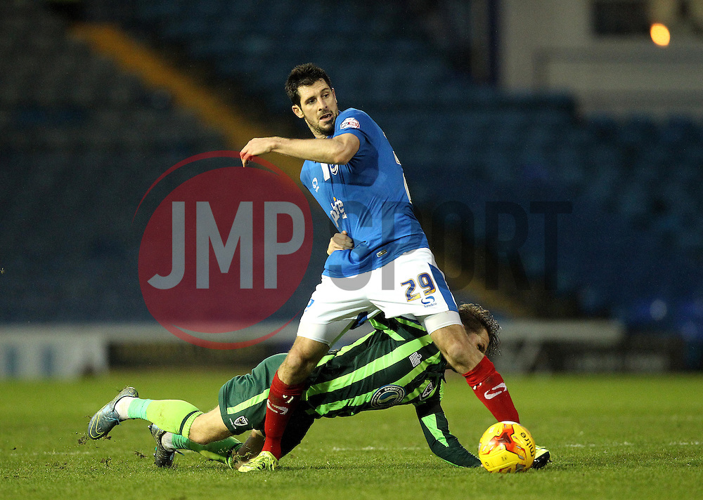 Danny Hollands of Portsmouth has his shirt pulled by Jake Reeves of AFC Wimbledon - Mandatory byline: Robbie Stephenson/JMP - 07966 386802 - 15/11/2015 - Rugby - Fratton Park - Portsmouth, England - Portsmouth v AFC Wimbledon - Sky Bet League Two