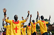 Members of a church group sing as they parade through the streets on a Sunday morning.<br /> Yei, Southern Sudan. 26/06/2011.