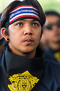 01 SEPTEMBER 2013 - BANGKOK, THAILAND: A student from a technical school in Bangkok marches in support of a Siam Pitak protest in Lumpini Park Sunday. Siam Pitak is one of several groups organized around opposition to the government of Yingluck Shinawatra, the Prime Minister of Thailand and brother of deposed and exiled former Prime Minister Thaksin Shinawatra, the brother of Yingluck. The Siam Pitak protest has been ongoing in Lumpini Park for more than a month.      PHOTO BY JACK KURTZ