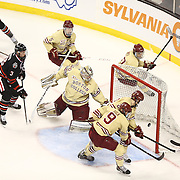 Josh Manson #3 of the Northeastern Huskies watches a shot go past Thatcher Demko #30 of the Boston College Eagles during The Beanpot Championship Game at TD Garden on February 10, 2014 in Boston, Massachusetts. (Photo by Elan Kawesch)