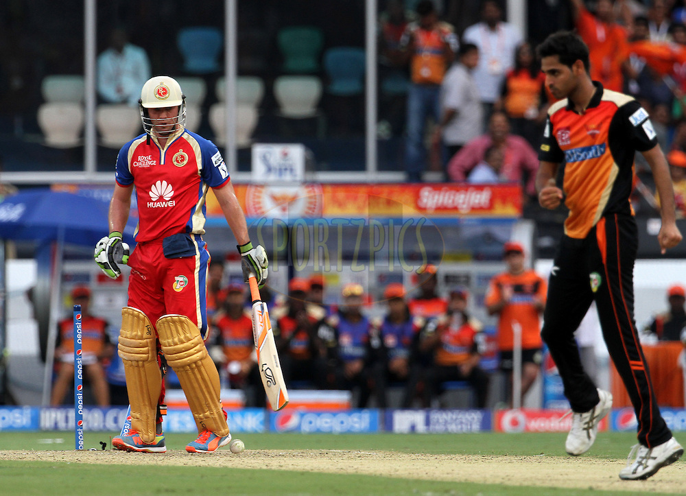 AB de Villiers of the Royal Challengers Bangalore is bowled by Bhuvneshwar Kumar of the Sunrisers Hyderabad during match 46 of the Pepsi Indian Premier League Season 2014 between the Sunrisers Hyderabad and the Royal Challengers Bangalore held at the Rajiv Gandhi Cricket Stadium, Hyderabad, India on the 20th May 2014<br /> <br /> Photo by Vipin Pawar / IPL / SPORTZPICS<br /> <br /> <br /> <br /> Image use subject to terms and conditions which can be found here:  http://sportzpics.photoshelter.com/gallery/Pepsi-IPL-Image-terms-and-conditions/G00004VW1IVJ.gB0/C0000TScjhBM6ikg