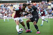 Liverpool forward Roberto Firmino (9) nutmegs Burnley defender James Tarkowski 5) during the Premier League match between Burnley and Liverpool at Turf Moor, Burnley, England on 31 August 2019.