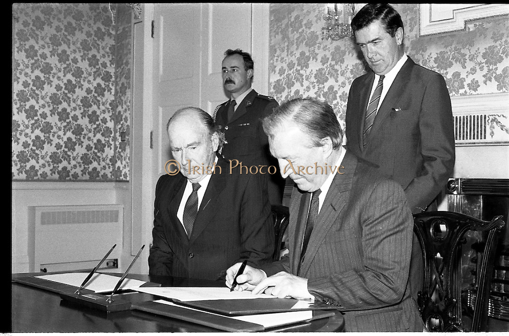 Dissolution Of The 25th Dáil.  (S4)..1989..25.05.1989..05.25.1989..25th May 1989..At the request of An Taoiseach,Mr Charles Haughey TD, President Patrick Hillery agreed to sign the order for the dissolution of the 25th Dáil. Fianna Fáil the outgoing government held the majority at 81 seats. This signing formally began the general election campaign for the 26th Dáil...Image shows President Patrick Hillery and An Taoiseach, Charles Haughey TD  signing the order to dissolve the government and so begin the general election campaign.