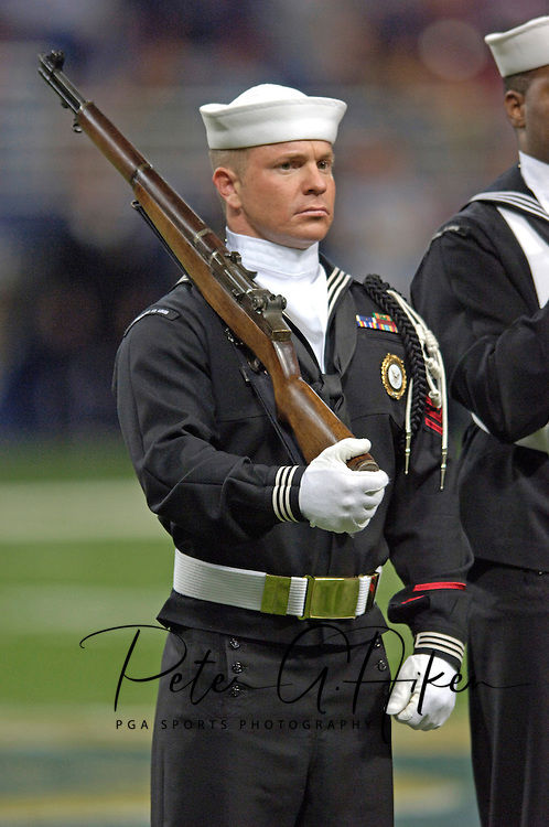 A member of the United States Navy Color Guard before the National Anthem at the Edward Jones Dome in St. Louis, Missouri, November 20, 2005.  The Cardinals beat the Rams 38-28.